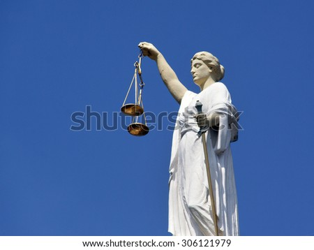 Rotterdam , Netherlands-august 13, 2015: Lady Justice  the personification of justice. An image of her is often available at courthouses this one is in Rotterdam - stock photo
