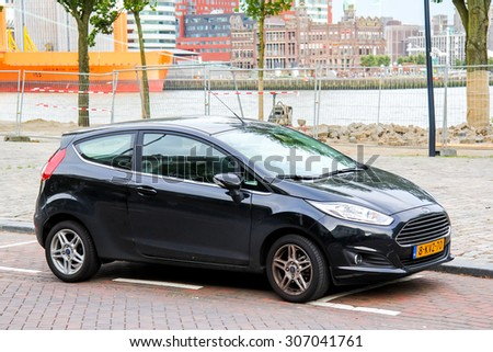 ROTTERDAM, NETHERLANDS - AUGUST 9, 2014: Motor car Ford Fiesta at the city street. - stock photo