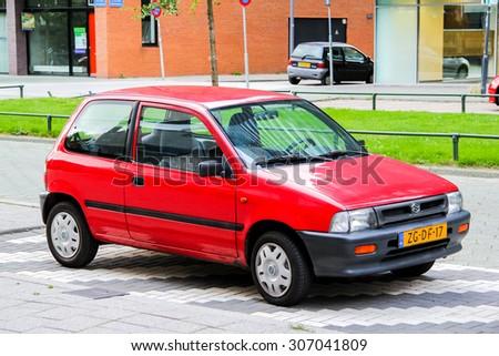 ROTTERDAM, NETHERLANDS - AUGUST 9, 2014: Motor car Suzuki at the city street. - stock photo