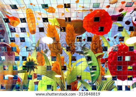ROTTERDAM, NETHERLANDS- Details of the famous Market hall taken on September 12, 2015. The inside of the building is painted with artwork of Arno Coenen.  - stock photo