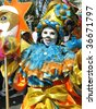 ROTTERDAM, NETHERLANDS - JULY 25: Masked girl in a summer carnival parade,  July 25, 2009, in Rotterdam, the Netherlands - stock photo