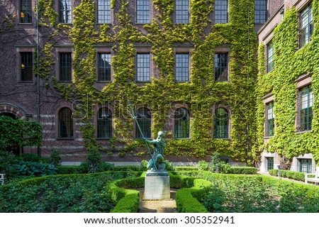 ROTTERDAM, NETHERLANDS - June 1: Symmetrical shot of the monumental facade, and a statue in the garden of the century old city hall in beaux-arts style on June 1, 2015, in Rotterdam, Netherlands - stock photo