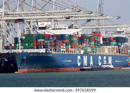 ROTTERDAM, NETHERLANDS - MAR 16, 2016: Container ship Christophe Colomb from CMA CGM moored at a container terminal in the Port of Rotterdam. - stock photo
