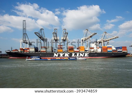 ROTTERDAM, NETHERLANDS - MAR 16, 2016: Container ship Nyk Oceanus from NYK Line moored at a container terminal in the Port of Rotterdam. - stock photo