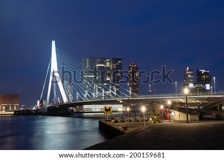 ROTTERDAM, NETHERLANDS - MAY 29, 2014: Erasmus Bridge (Dutch: Erasmusbrug) in the city centre of Rotterdam at night on May 29, 2014 in Rotterdam, South Holland, the Netherlands. - stock photo