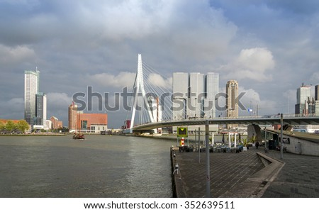 Rotterdam, Netherlands - May 9, 2015: Erasmus Bridge with Skyscraper in Rotterdam, The Netherlands. Rotterdam has always been one of the main centres of the shipping industry in the Netherlands. - stock photo