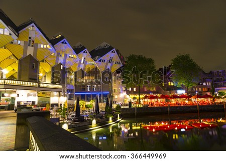 "ROTTERDAM, NETHERLANDS - MAY 24, 2015: Historical ""Oude Haven"" district with restaurants and view of the Cube Houses of Rotterdam, designed by architect Piet Blom"