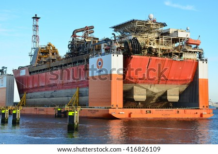 Rotterdam, Netherlands - May 13, 2015:Semi-submersible heavy superstructure lift ship designed to move offshore oil and gas facilities in the port of Rotterdam, Netherlands.