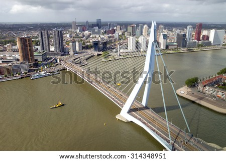ROTTERDAM, NETHERLANDS: SEP 5, 2015: Aerial view on the Erasmus bridge and downtown Rotterdam.  - stock photo