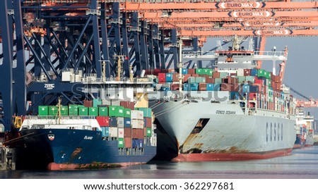 ROTTERDAM, NETHERLANDS - SEP 8, 2012: Container ships moored at the Euromax container terminal in the Port of Rotterdam.  - stock photo