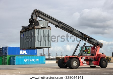 ROTTERDAM, NETHERLANDS - SEP 6, 2015: Mobile container handler in action at a container terminal in the Port of Rotterdam - stock photo