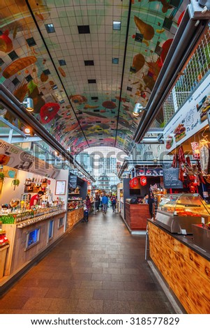 ROTTERDAM, NETHERLANDS - SEPTEMBER 03, 2015: inside of the new market hall in Rotterdam with unidentified people. It was opened on Oct 1, 2014, by Queen Maxima and designed by architects MVRDV - stock photo