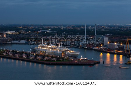 ROTTERDAM,NETHERLANDS - SEPTEMBER 28: The tourist liner in port, September 28, 2012, Rotterdam, Netherlands. The port area in Rotterdam makes 105 square km, at length it is extended on 40 km