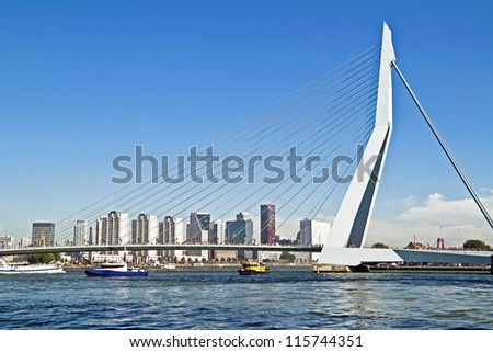 ROTTERDAM, NETHERLANDS - SEPTEMBER 09: View on Erasmus Bridge and Rotterdam port. Erasmus Bridge is one of the icons of Rotterdam on September 9, 2012 in Rotterdam, The Netherlands - stock photo