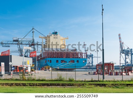 ROTTERDAM - OCTOBER 4, 2014: Container ship in Rotterdam port. It is the largest port in Europe, covering 105 square kilometers (41 sq miles)