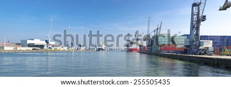 ROTTERDAM - OCTOBER 4, 2014: Container terminal in Rotterdam port. It is the largest port in Europe, covering 105 square kilometers (41 sq miles) - stock photo