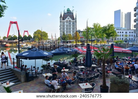 ROTTERDAM - SEPTEMBER 18: Diners enjoying alfresco dining with a view of the Witte Huis (White House) at Wijnhaven, taken on September 18, 2014 in Rotterdam, Netherlands - stock photo