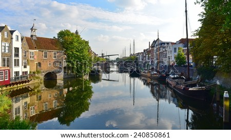 ROTTERDAM - SEPTEMBER 18: Historic houses along river Nieuwe Maas at Delfshaven, a borough of Rotterdam, taken on September 18, 2014 in Rotterdam, Netherlands - stock photo