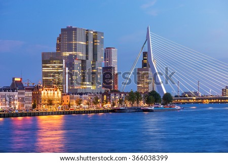 Rotterdam Skyline with Erasmus bridge at twilight, The Netherlands - stock photo