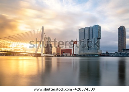 Rotterdam Skyline with Erasmusbrug bridge in morning in Rotterdam, Netherlands.  Rotterdam is a city in South Netherlands - stock photo