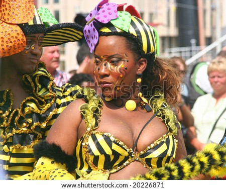 ROTTERDAM - SUMMER CARNIVAL, JULY 26, 2008. Carnival dancers with Bee theme at the Caribbean carnival parade in Rotterdam on July 26.