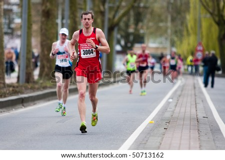 ROTTERDAM, THE NETHERLANDS - APRIL 11 : Annual Fortis Rotterdam Marathon. Runners on the city streets on April 11, 2010 in Rotterdam - stock photo