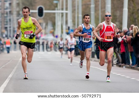 ROTTERDAM, THE NETHERLANDS - APRIL 11 : Annual Fortis Rotterdam Marathon. Runners on the city streets on April 11, 2010 in Rotterdam, The Netherlands. - stock photo