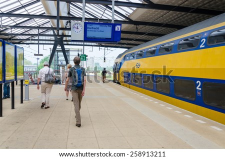 ROTTERDAM, THE NETHERLANDS - APRIL 16: Unknown travellers are entering and leaving an intercity train at the central station of Rotterdam on April 16, 2014 in the city of Rotterdam, the Netherlands - stock photo