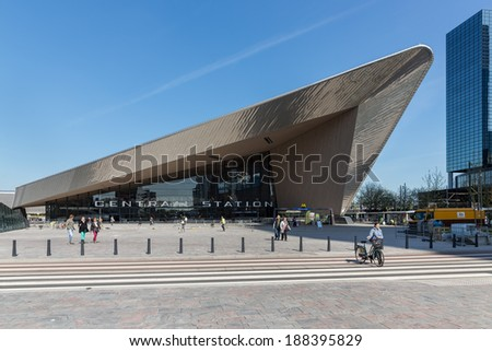 ROTTERDAM, THE NETHERLANDS - APRIL 16: Unknown travellers are entering and leaving the new in 2014 rebuild central station of Rotterdam on April 16, 2014 in the city of Rotterdam, the Netherlands