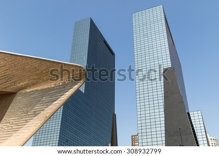 ROTTERDAM, THE NETHERLANDS - AUGUST 22 2015: Central station roof with two office buildings