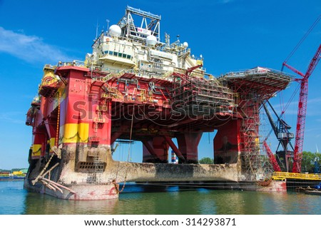 ROTTERDAM, THE NETHERLANDS - AUGUST 9, 2015: Large steel platform in the Port of Rotterdam, South Holland, The Netherlands. Rotterdam Port is the largest port in Europe. - stock photo