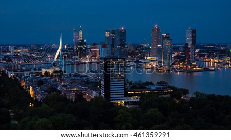 "Rotterdam, the Netherlands, july 27 2016: A view over the south of rotterdam depiction the erasmusbrug and ""de kop van zuid"" just after sunset during the blue hour"