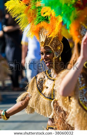 ROTTERDAM, THE NETHERLANDS - JULY 25: Beautiful girl in the parade of the annual Summer Carnival in Rotterdam on July 25, 2009 in Rotterdam, The Netherlands - stock photo