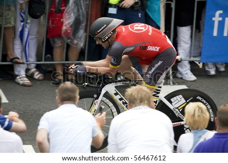ROTTERDAM, THE NETHERLANDS - JULY 2: Lance Armstrong participates in the Prologue of the Tour de France 2010 July 2, 2010 in Rotterdam, The Netherlands - stock photo