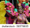 ROTTERDAM, THE NETHERLANDS - JULY 31: Performer dressed  in a costume with fruits participates at the Summer Carnival in Rotterdam on july 31, 2010. It attracts around 1 million visitors yearly - stock photo