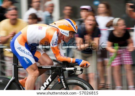 ROTTERDAM, THE NETHERLANDS - JULY 3 : Tour de France - annual bicycle race. Cyclist from Rabobank team during first day of competition - prologue race on the city streets on July 3, 2010 in Rotterdam - stock photo