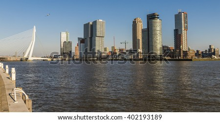 Rotterdam, The Netherlands - March 1, 2016: Wilhelminapier in Rotterdam with skycrapers, offices, Erasmus Bridge and Hotel New York. - stock photo