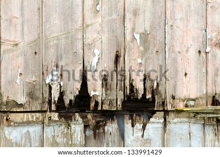 rotting wooden panels crumbling with decay - stock photo
