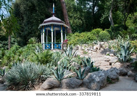 Rotunda standing among cactus flowers at Nikitsky botanical garden, Crimea - stock photo