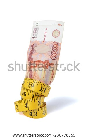 Rouble bills and measure tape over white - stock photo
