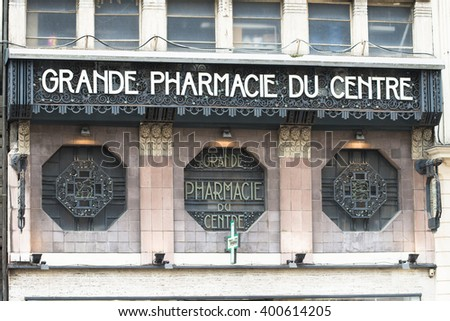 ROUEN, FRANCE - JULY 2, 2015: Modernist facade of a pharmacy in one of the streets of the French city. - stock photo