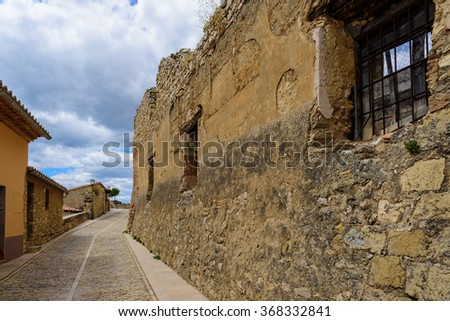 Rough ancient wall in Morella street, the province of Castellon, Spain. - stock photo