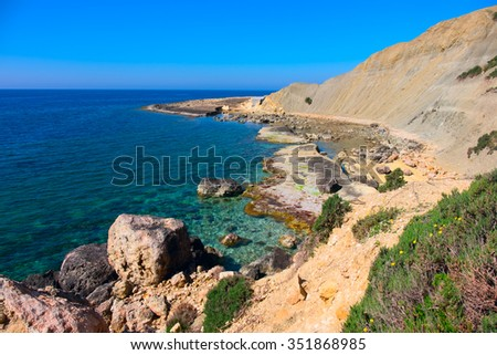 rough and rocky coastline of the island of malta , europe - stock photo