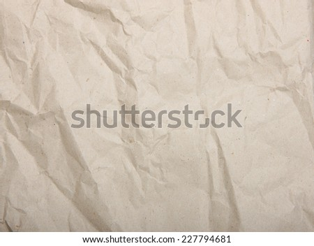 Rough beige crumpled recycled paper texture - stock photo