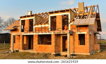 Rough brick building house under construction. New House Concepts - stock photo