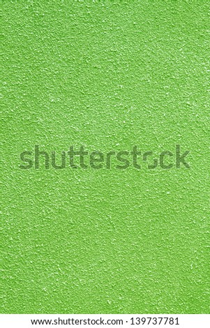 Rough cement wall surface is not smooth green - stock photo