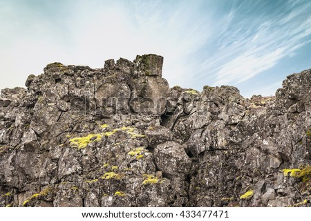 Rough cliffs with green moss in Iceland - stock photo
