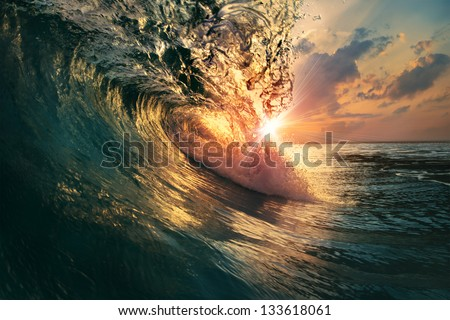 rough colorful ocean breaking surf wave falling down at sunset time - stock photo