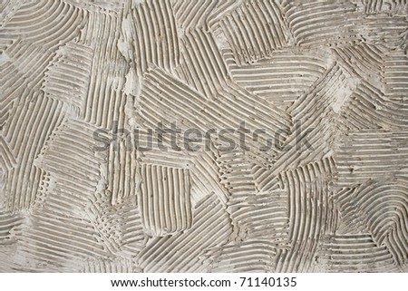 rough dabs of grey putty on the wall - stock photo