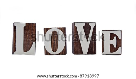 rough edged wooden blocks spelling out the word love